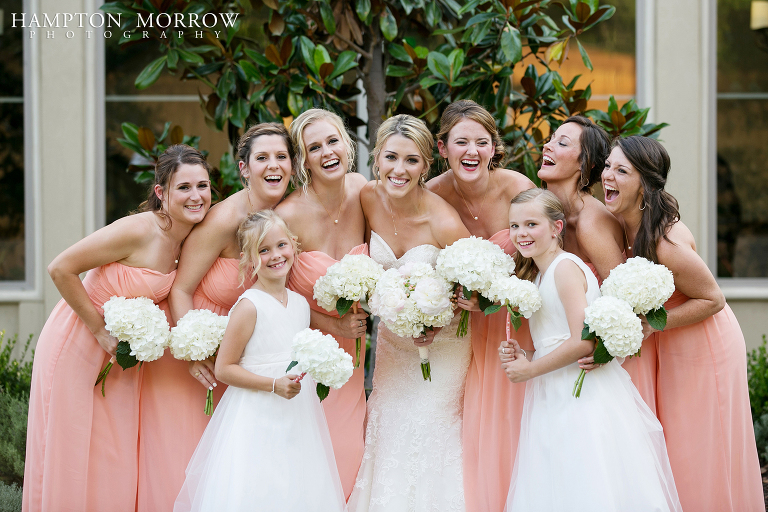 fun bridal party in coral at chapel ana villa